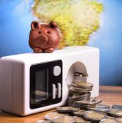brown piggy on electric meter - stock photo