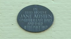 Plaque on the house where Jane Austen spend her last days in Winchester UK Stock Footage