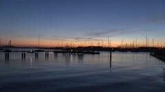 Sunset over Hamble Point Marina from Warsash, River Hamble, Hampshire, UK. Stock Footage
