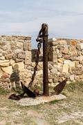 Anchor of ship in tenedos castle Stock Photos
