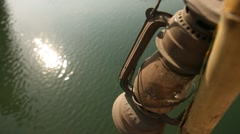 Old kerosene lamp at tree Stock Footage