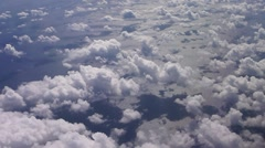 Fluffy Clouds over Pacific Ocean Aerial Stock Footage