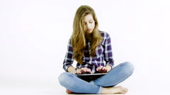 Blond teenager girl with long hair writing with tablet Stock Footage