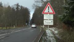 Road warning sign - bad road conditions next 1.5 km Stock Footage