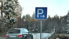Road sign parking area - passing car Stock Footage