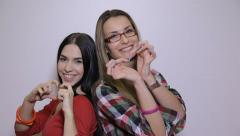 Two young women pose together Stock Footage