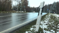 Bad road conditions, wet asphalt, passing cars Stock Footage