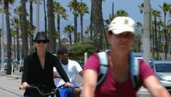 4K, UHD, Riding bicycles in Santa Monica, California, BlackMagic Camera Stock Footage