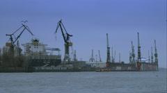 Ships, cranes, and seagulls at hamburg port Stock Footage
