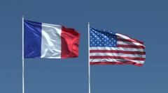 American and French flags flying together on Utah Beach, Manche, France. Stock Footage
