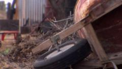 Over turned rusty wheelbarrow abandoned with dead desert brush dolly shot Stock Footage