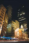 buildings at the intersection of state street and congress street at night in - stock photo