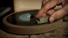 Vintage record player playing 45 vinyl record with old mans hand Stock Footage