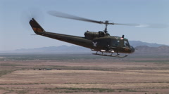 Huey gunship flying Stock Footage