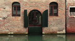 Venice Italy home wall door along canal HD 4075 Stock Footage