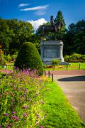 flowers and statue of george washington at the commons in boston, massachuset - stock photo