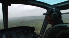On a mission in a Huey gunship Stock Footage