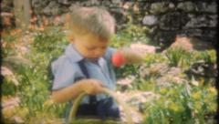 1576 - children enjoy an Easter egg hunt - vintage film home movie Stock Footage