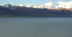 4k huge clouds mass rolling over lake namtso & snow mountain,tibet mansarovar. Stock Footage