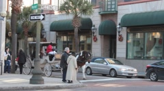 Tourists riding horse carriage walking down historical street Stock Footage
