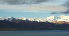 4k huge clouds mass rolling over lake namtso & snow mountain,tibet mansarovar. Stock Footage