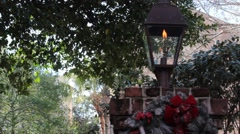 0ld traditional fire lit lamp post surrounded by trees Stock Footage