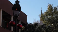 Old traditional fire-lit lamp post in historical town Stock Footage