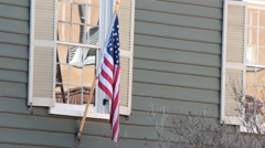 Flag flying outside of old historical building Stock Footage