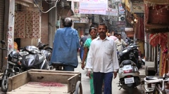 Indian people in a narrow street during traffic. Amritsar, India Stock Footage