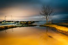 The waterfront at night, in havre de grace, maryland. Stock Photos