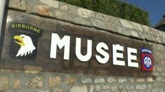 Sign at the entrance to the Airborne museum, Sainte-Mère-Eglise, Normandy. Stock Footage