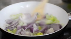 Sauteeing onion and leek Stock Footage