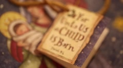 A christmas tag says for unto us a child is born Stock Footage