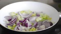 Sauteeing onion and leek - stock footage