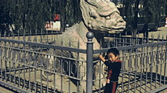 China 1987: child in front of a statue at the entrance of Ming Tomb - stock footage