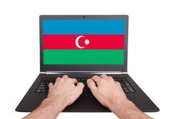 Stock Photo of hands working on laptop, azerbaijan