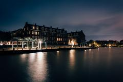 waterfront condominiums and promenade along the potomac river at night in ale - stock photo