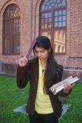 Exam pressure: tense indian college student in campus. Stock Photos