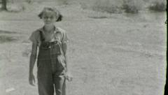 Cute Farmgirl in Overalls Farm Girl Summer Vintage Film Retro Home Movie 8074 Stock Footage