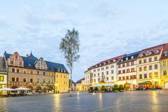 people enjoy sunset at central market place in weimar - stock photo