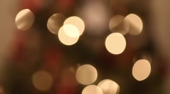 An out of focus christmas tree light and ornaments Stock Footage
