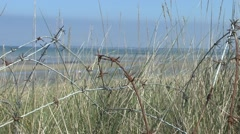 View through barbed wire towards Utah Beach, Manche, France. Stock Footage