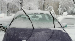 Frozen Car Windshield With Windshields Wipers Up in Blizzard, Still Shot Stock Footage