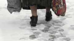 Old Woman Feet Walking Slow On A Narrow Path In Snow, City Street, Blizzard Stock Footage
