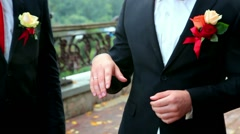 Groom With Best Man And Groomsmen At Wedding looking at wedding ring Stock Footage
