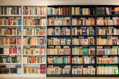 Bookshelf In Library With Many Old Second-Hand Books Stock Photos