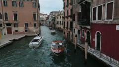 Venice Italy narrow canal luxury water taxi HD 4091 Stock Footage