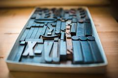 Old wooden printing type, font characters Stock Photos