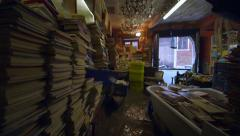 Waves inundate flooded bookshop as boat passes, Venice Stock Footage