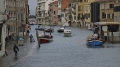 Flooded canal and street, venice, italy - sea level rise due to changing climate Stock Footage